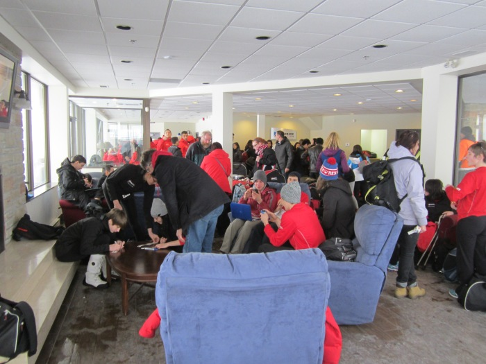 Waiting in the tiny terminal lobby with the rest of Team Ontario