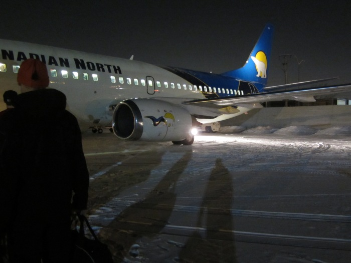 Walking across the tarmac to our charter plane